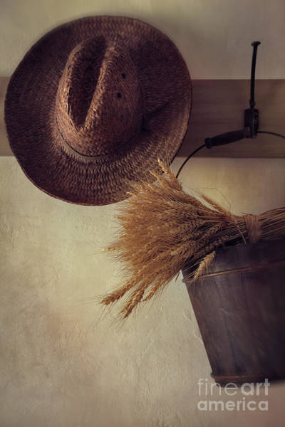 Photograph - Straw Hat Hanging On Coat Hook by Sandra Cunningham