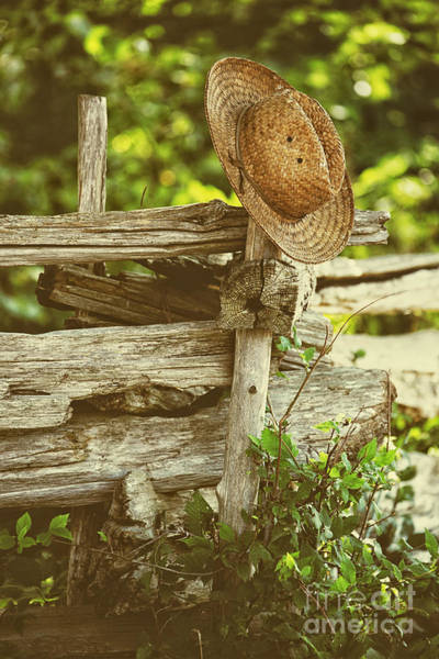 Photograph - Straw Hat Hanging On Fence by Sandra Cunningham