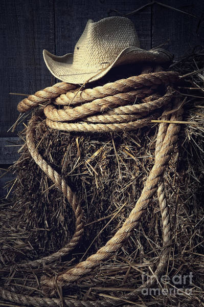 Photograph - Straw Hat With Rope On A Bale Of Hay In Barn by Sandra Cunningham