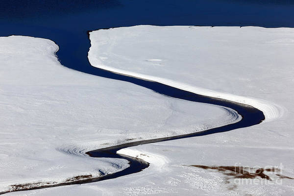 Photograph - Stream Flowing Into A Lake In Winter by James Brunker