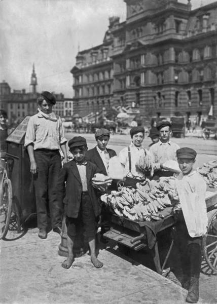 Fruit Stand Wall Art - Photograph - Street Banana Vendor Boys by Underwood Archives