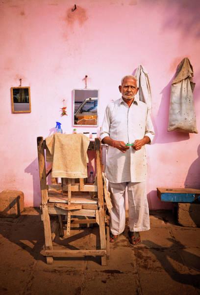 Senior Adult Photograph - Street Barber In India by Nikada