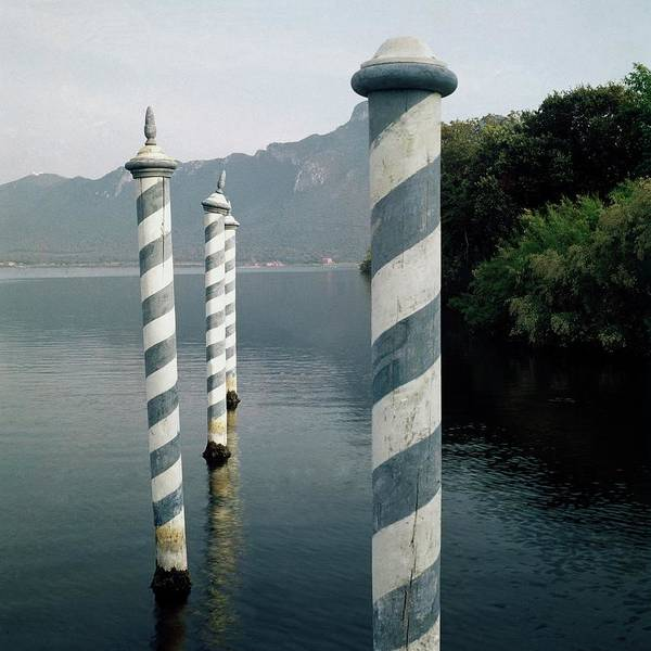 Water Photograph - Striped Posts In The Grand Canal by Leombruno-Bodi