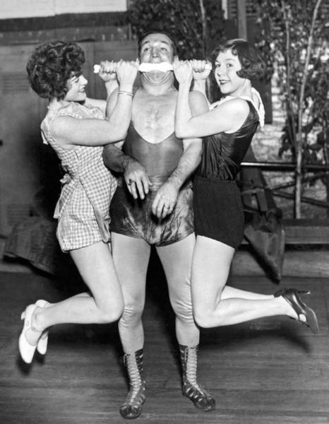 Lifting Photograph - Strongman Lifts With His Teeth by Underwood Archives