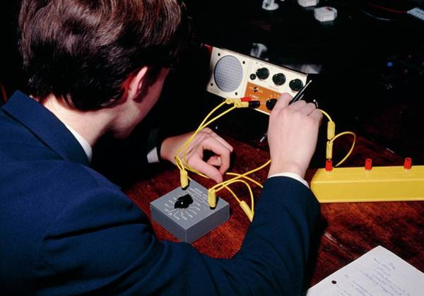 Lessons Photograph - Student Does A Physics Experiment by David Taylor/science Photo Library