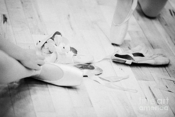 Wall Art - Photograph - Students Putting On Pointe Shoes At A Ballet School In The Uk by Joe Fox