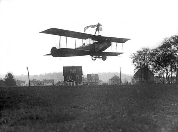 1921 Photograph - Stunts Atop A Biplane by Underwood Archives