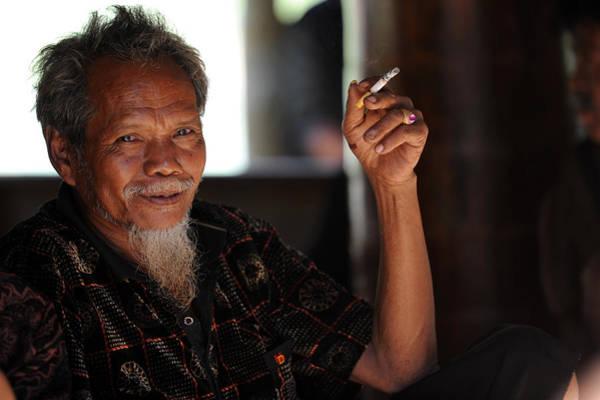 Wall Art - Photograph - Sulawesian Smoker by Jessica Rose