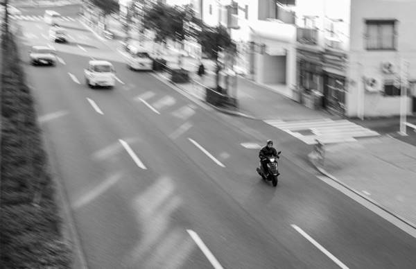 Wall Art - Photograph - Sumida Biker by Ryan Routt
