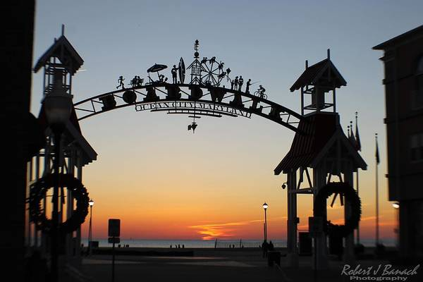 Photograph - Sun Reflecting On Clouds Ocean City Boardwalk Arch by Robert Banach