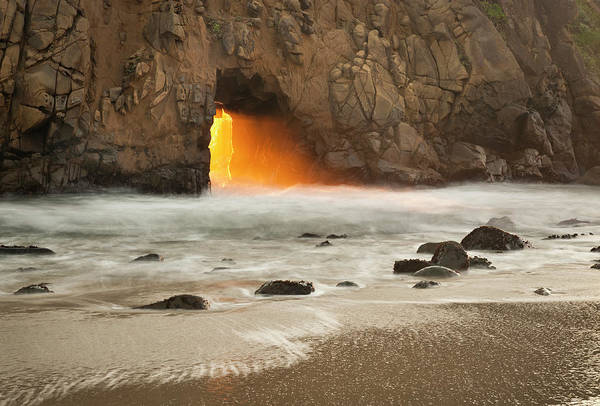 Setting Photograph - Sun Setting Through Arch In Rock At by Doug Steakley