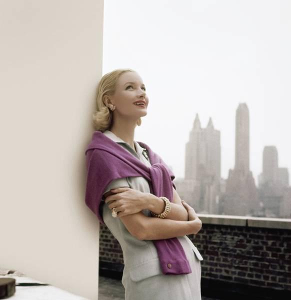 Skyline Photograph - Sunny Harnett Leaning On Wall by Horst P. Horst