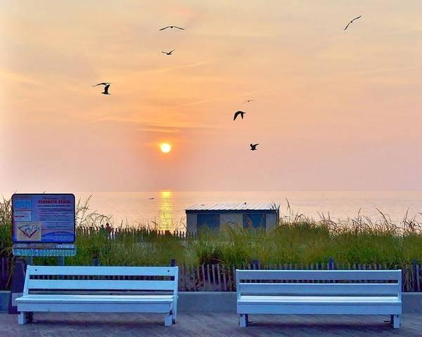 Bemis Photograph - Sunrise At Rehoboth Beach Boardwalk by Kim Bemis