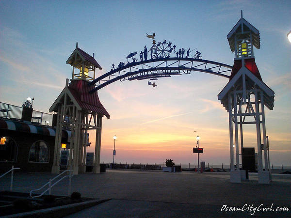 Photograph - Sunrise At The Ocean City Arch by Robert Banach