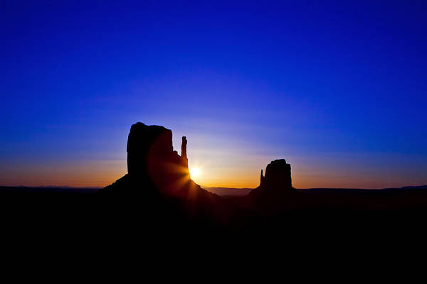 Navajo Indian Reservation Photograph - Sunrise Over Monument Valley by Susan Schmitz