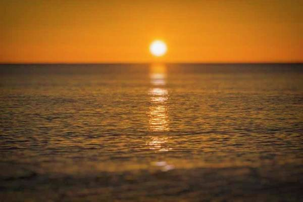 Wall Art - Photograph - Sunrise Over The Sea by Ken Welsh
