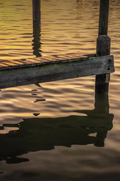 Photograph - Sunrise Reflections On The Water By A Boat Dock by Randall Nyhof