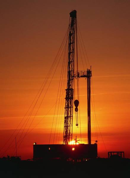 Drilling Photograph - Sunset At An Onshore Gas Drilling Rig by Chris Knapton/science Photo Library