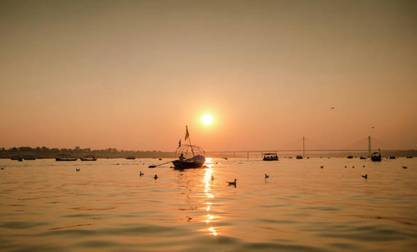 Ganges River Photograph - Sunset At Ganga by Karthi Kn Raveendiran