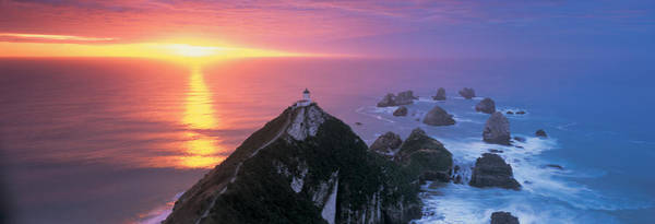 Promontory Point Photograph - Sunset, Nugget Point Lighthouse, South by Panoramic Images
