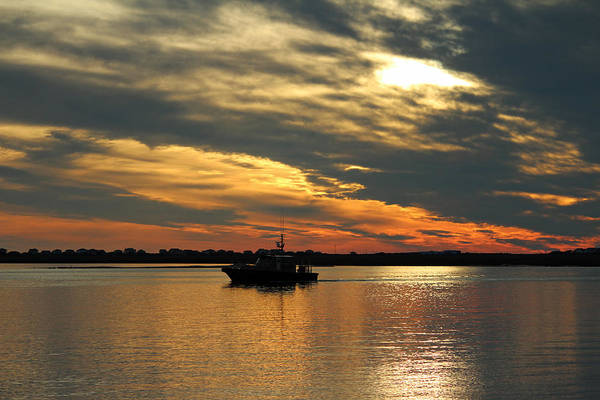 Disappearance Photograph - Sunset Over The Water by Cynthia Guinn
