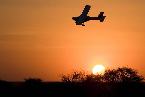 Kimberley Airport Photograph - Sunset Plane by Paul Job