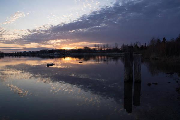 Photograph - Sunset Sentinels - Three Pillars Guarding The Sundown Reflections by Georgia Mizuleva