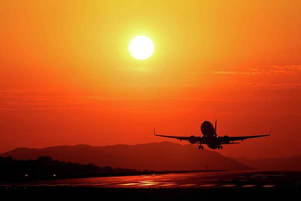 Taking Off Photograph - Sunset Takeoff by Shunichi Yoneyama