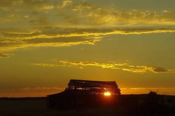 Sun Set Photograph - Sunset Through An Old Barn by Jeff Swan