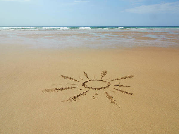 Photograph - Sunshine Drawn In Sand At Beach by Dougal Waters