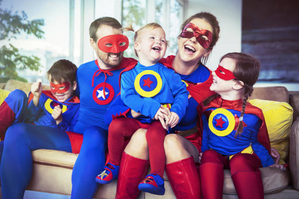 Superhero Family Laughing On Sofa Art Print by Robert Daly