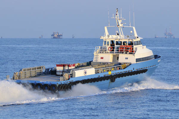 Photograph - Supply Vessel Heads To Sea by Bradford Martin