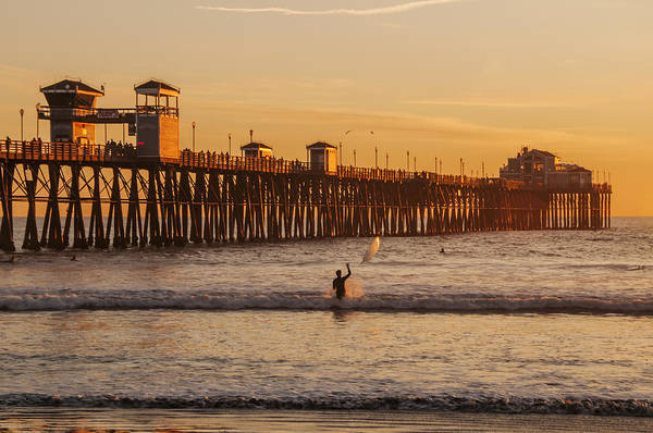 Photograph - Surfer At Oceanside Pier by Lee Kirchhevel