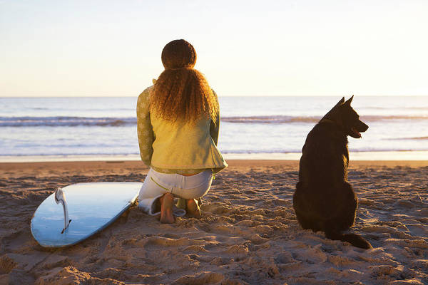 Longboard Photograph - Surfer Woman And Dog On Beach by Ty Milford