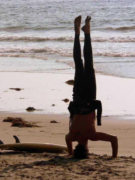 Photograph - Surfer Yoga Headstand by Jeff Lowe