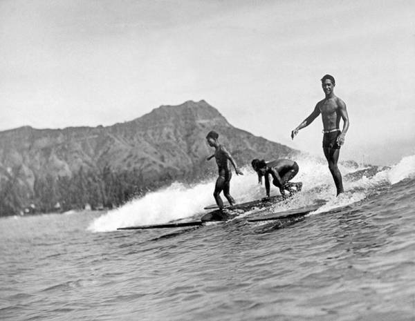 Pursuit Photograph - Surfing In Honolulu by Underwood Archives