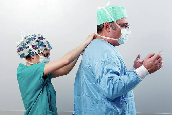 Plastic Surgery Wall Art - Photograph - Surgeon Being Dressed by Mauro Fermariello/science Photo Library