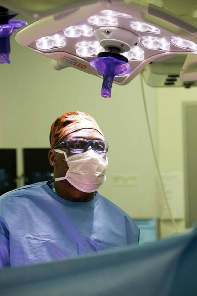 Wall Art - Photograph - Surgeon Performing An Operation by Mark Thomas/science Photo Library