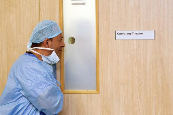 Wall Art - Photograph - Surgeon Watching An Operation by Mark Thomas/science Photo Library
