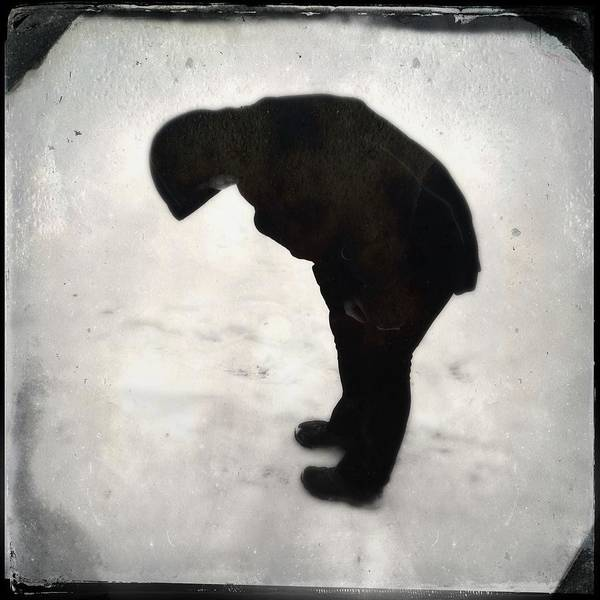 Surrealism Photograph - Surreal Silhouette Of A Person In The Snow by Matthias Hauser