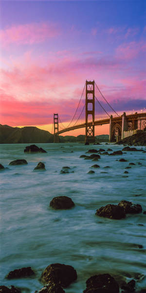 Peacefulness Photograph - Suspension Bridge Across A Bay At Dusk by Panoramic Images