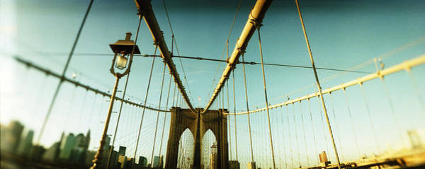 Wall Art - Photograph - Suspension Bridge With A City by Panoramic Images