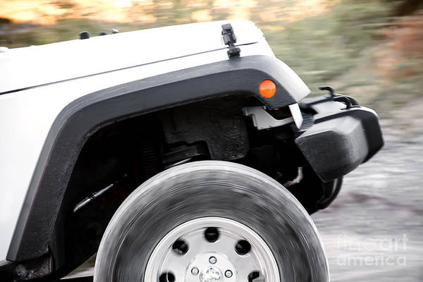 Photograph - Suv Off Road Vehicle In Action With Spinning Wheel by Gunter Nezhoda