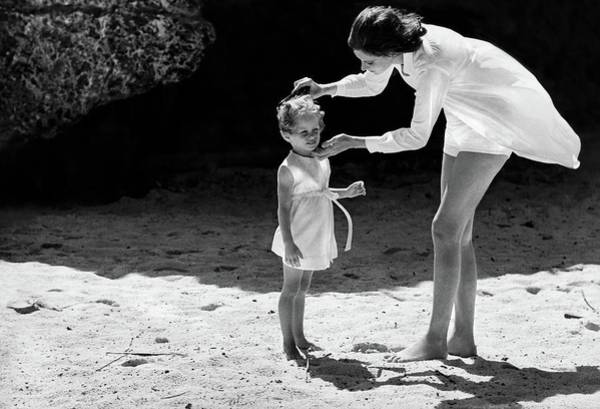 Illuminated Photograph - Suzy Parker With Her Daughter At Sam Lord's by Henry Clarke