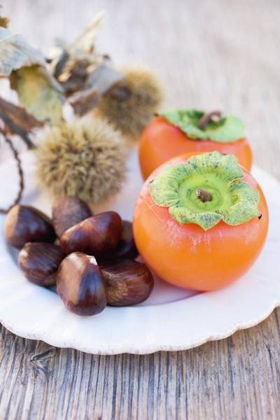 Wall Art - Photograph - Sweet Chestnuts And Persimmons On Plate by Eising Studio - Food Photo and Video