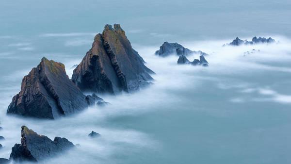 High Tide Photograph - Swirling Tide Around Jagged Rocks by Sebastian Wasek