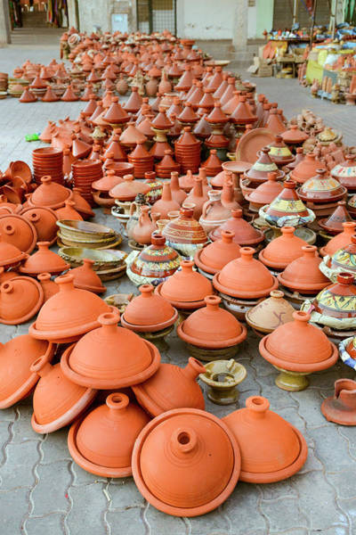 Vertical Perspective Photograph - Tajine Pottery Stacked In A Market by Paolo Negri