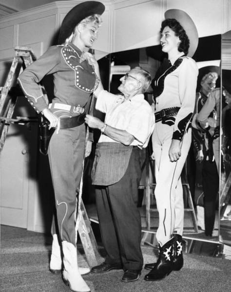 1958 Photograph - Tall Cowgirls Get Fitted by Underwood Archives