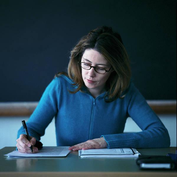 Classroom Photograph - Teacher Marking Work by Cristina Pedrazzini/science Photo Library