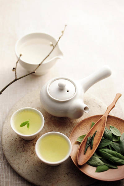 Tea Photograph - Teapot And Cup With Green Tea by Cooksimage / Multi-bits